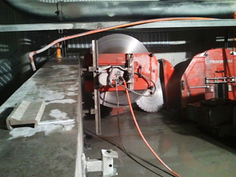 Track mounted wall saw